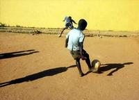 boy_playing_football_in_zambia_medium.jpg